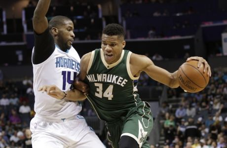 Milwaukee Bucks' Giannis Antetokounmpo (34) drives against Charlotte Hornets' Michael Kidd-Gilchrist (14) in the second half of an NBA basketball game in Charlotte, N.C., Tuesday, March 28, 2017. The Bucks won 118-108. (AP Photo/Chuck Burton)