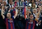Barcelona's Andres Iniesta, left, and  Xavi Hernandez lift the trophy after winning the final of the Copa del Rey soccer match between FC Barcelona and Athletic Bilbao at the Camp Nou stadium in Barcelona, Spain, Saturday, May 30, 2015. (AP Photo/Manu Fernandez)