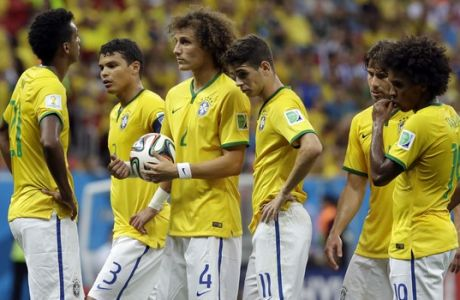 Brazil's David Luiz, center, stands with teammates before a free kick during the World Cup third-place soccer match between Brazil and the Netherlands at the Estadio Nacional in Brasilia, Brazil, Saturday, July 12, 2014. (AP Photo/Hassan Ammar)