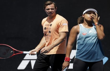 Sascha Bajin, coach of Japan's Naomi Osaka talks with her during a practice session at the Australian Open tennis championships in Melbourne, Australia, Friday, Jan. 25, 2019. Osaka will play Petra Kvitova of the Czech Republic in Saturday's women's final. (AP Photo/Mark Baker)