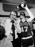 FILE - In this May 12, 1974, file photo, Boston Celtic's John Havlicek (17) pours champagne on the head of coach Tom Heinsohn in the dressing room after the Celtics 102-87 win over Milwaukee Bucks to win the NBA basketball championship in Milwaukee, Wis. Heinsohn is one of 12 finalists up for election into the Basketball Hall of Fame, the hall of fame announced Friday, Feb. 15, 2013. The 2013 class will be announced at the Final Four in April. (AP Photo/File)
