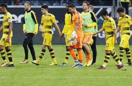 Dortmund players leave the pitch after a German first division Bundesliga match between Eintracht Frankfurt and Borussia Dortmund in Frankfurt, Germany, Saturday, Oct. 21, 2017. (AP Photo/Michael Probst)