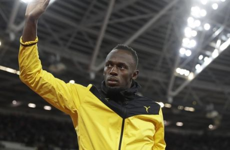 Jamaica's Usain Bolt bids farewell during a lap of honor at the end of the World Athletics Championships in London Sunday, Aug. 13, 2017. (AP Photo/Matthias Schrader)
