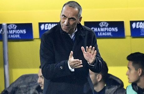 APOEL Nicosia coach Giorgos Donis clap his players during the Champions League group H soccer match between Borussia Dortmund and APOEL Nicosia in Dortmund, Germany, Wednesday, Nov. 1, 2017. (AP Photo/Martin Meissner)