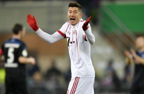 Bayern's Robert Lewandowski reacts during the German soccer cup quarterfinal match between SC Paderborn and Bayern Munich in Paderborn, Germany, Tuesday, Feb. 6, 2018. (AP Photo/Martin Meissner)