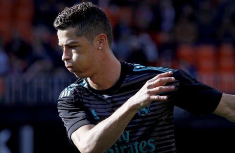 Real Madrid's Cristiano Ronaldo warms up prior to the start of the Spanish La Liga soccer match between Valencia and Real Madrid at the Mestalla stadium in Valencia, Spain, Saturday, Jan. 27, 2018. (AP Photo/Alberto Saiz)
