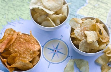 In this image taken on July 30, 2012, from left, Poore Brothers Habanero, Route 11 Chips Chesapeake Crab, and Boulder Canyons Red Wine Vinegar, potato chips are shown in Concord, N.H. (AP Photo/Matthew Mead)