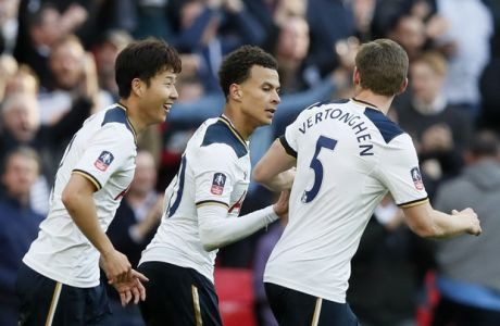 Tottenham Hotspur's Dele Alli, center, celebrates scoring his side's second goal with Son Heung-min, left, and Jan Vertonghen during the English FA Cup semifinal soccer match between Chelsea and Tottenham Hotspur at Wembley stadium in London, Saturday, April 22, 2017. (AP Photo/Kirsty Wigglesworth)