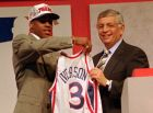 Allen Iverson, left, of Georgetown holds up a jersey with NBA commissioner David Stern after being selected as the number one pick in the 1996 NBA draft by the Philadelphia 76ers Wednesday night, June 26, 1996, in East Rutherford, N.J.  (AP Photo/Ron Frehm)