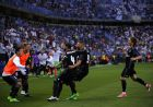 Real Madrid's Karim Benzema celebrates with Sergio Ramos scoring his side's 2nd goal during a Spanish La Liga soccer match between Malaga and Real Madrid in Malaga, Spain, Sunday, May 21, 2017. (AP Photo/Daniel Tejedor)