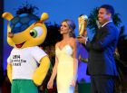 SAO PAULO, BRAZIL - JUNE 10:  Ex-Brazil international footballer Ronaldo holds the FIFA World Cup Trophy as MC Fernanda Lima looks on during the Opening Ceremony of the 64th FIFA Congress at the Transamerica Expo Center on June 10, 2014 in Sao Paulo, Brazil.  (Photo by Alexander Hassenstein - FIFA/FIFA via Getty Images)