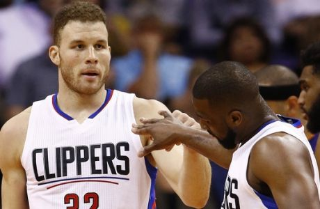Los Angeles Clippers' Blake Griffin (32) slaps hands with Raymond Felton after Griffin scored against the Phoenix Suns during the second half of an NBA basketball game Thursday, March 30, 2017, in Phoenix. The Clippers defeated the Suns 124-118. (AP Photo/Ross D. Franklin)