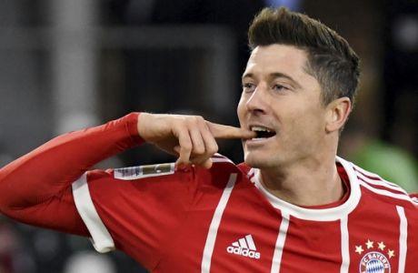 Munich's  Robert Lewandowski celebrates a goal during the German Bundesliga soccer match between VfL Wolfsburg and Bayern Munich, in Wolfsburg, northern Germany, Saturday, Feb. 17, 2018. (Peter Steffen/dpa via AP)