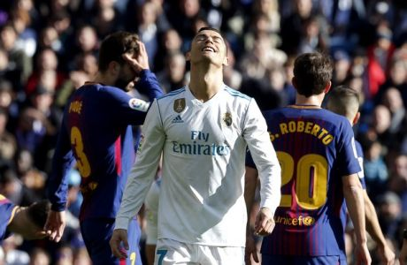 Real Madrid's Cristiano Ronaldo reacts during the Spanish La Liga soccer match between Real Madrid and Barcelona at the Santiago Bernabeu stadium in Madrid, Spain, Saturday, Dec. 23, 2017. (AP Photo/Paul White)