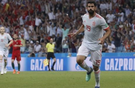 Spain's Diego Costa celebrates after scoring his sides 1st goal during the group B match between Portugal and Spain at the 2018 soccer World Cup in the Fisht Stadium in Sochi, Russia, Friday, June 15, 2018. (AP Photo/Manu Fernandez)