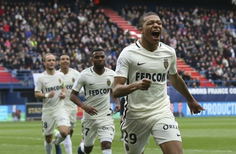 Monaco's Kylian Mbappe celebrates after scoring his first goal during their French League One soccer match against Caen, in Caen, north western France, Sunday, March 19, 2017. Mbappe scored two goals as Monaco won 3-0. (AP Photo/David Vincent)
