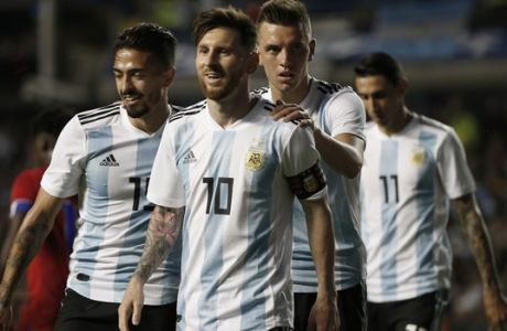 FILE - In this May 29, 2018 file photo Argentina's Manuel Lanzini, left, Giovanni Lo Celso, second right, and Angel Di Maria, right, congratulate teammate Lionel Messi, second left, after his hat trick during a friendly soccer match between Argentina and Haiti at the Bombonera stadium in Buenos Aires, Argentina. In theory, two-time World Cup winner Argentina really shouldn't be fearful of facing Iceland, which is making its first appearance at the tournament. But there is a bit of worry in the Argentina camp: the height effect because Argentina is among the shortest teams at the tournament at 1.79 meters (AP Photo/Natacha Pisarenko)
