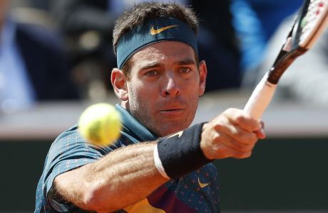 Argentina's Juan Martin del Potro plays a shot against Chile's Nicolas Jarry during their first round match of the French Open tennis tournament at the Roland Garros stadium in Paris, Tuesday, May 28, 2019. (AP Photo/Pavel Golovkin)