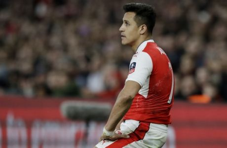 Arsenal's Alexis Sanchez rests on the ground during the English FA Cup quarterfinal soccer match between Arsenal and Lincoln City at the Emirates stadium in London, Saturday, March 11, 2017. (AP Photo/Matt Dunham)