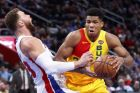 Milwaukee Bucks forward Giannis Antetokounmpo (34) charges into Detroit Pistons forward Blake Griffin (23) in the first half of an NBA basketball game in Detroit, Monday, Dec. 17, 2018. (AP Photo/Paul Sancya)