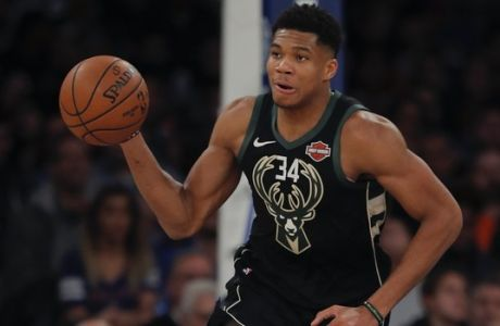 Milwaukee Bucks forward Giannis Antetokounmpo (34) brings the ball down court during the second half of an NBA basketball game against the New York Knicks, Saturday, Dec. 1, 2018, in New York.(AP Photo/Julie Jacobson)
