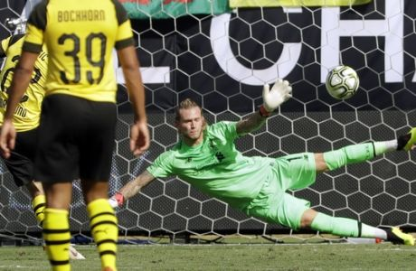 Liverpool's Loris Karius (1) can't stop a penalty kick by Borussia Dortmund's Christian Pulisic (22) during the second half of an International Champions Cup tournament soccer match in Charlotte, N.C., Sunday, July 22, 2018. (AP Photo/Chuck Burton)