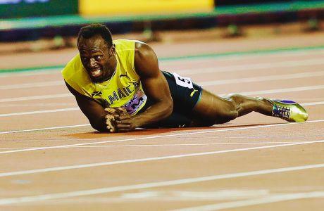 Ο Γιουσέιν Μπολτ κατά τη διάρκεια του τραυματισμού του στον τελικό 4Χ100μ. του Παγκοσμίου Πρωταθλήματος ανοιχτού στίβου 2017, Λονδίνο, Σάββατο 12 Αυγούστου 2017