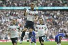 Tottenham's Harry Kane, center, celebrates after scoring his side's first goal during the English FA Cup semifinal soccer match between Chelsea and Tottenham Hotspur at Wembley stadium in London, Saturday, April 22, 2017. (AP Photo/Tim Ireland)