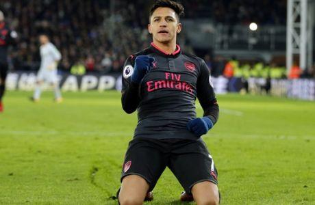 Arsenal's Alexis Sanchez celebrates after scoring his side's second goal of the game during their English Premier League soccer match between Crystal Palace and Arsenal at Selhurst Park stadium in London, Thursday, Dec. 28, 2017. (AP Photo/Alastair Grant)