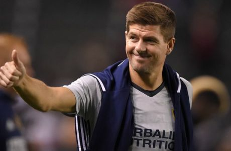 FILE - In this Feb. 9, 2016, file photo, Los Angeles Galaxy midfielder Steven Gerrard, gestures to fans after a soccer match against Club Tijuana, in Carson, Calif. Gerrard is returning to Liverpool, England, it was announced Friday, Jan. 20, 2017, to take up a position in the team's youth academy, starting in February. (AP Photo/Mark J. Terrill, File)