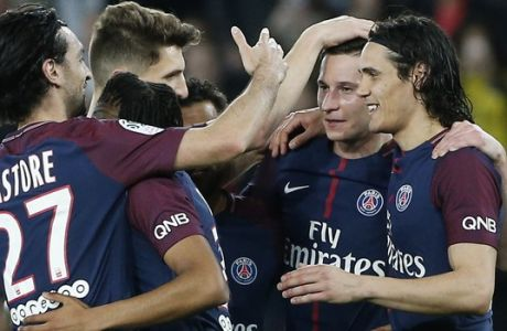 PSG players celebrate with Julian Draxler, second right, who scored his side's seventh goal during the French League One soccer match between Paris Saint Germain and Monaco at the Parc des Princes stadium in Paris, Sunday, April 15, 2018. (AP Photo/Thibault Camus)