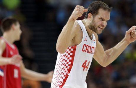 Croatia's Bojan Bogdanovic (44) reacts after making a three-point basket during a quarterfinal round basketball game against Serbia at the 2016 Summer Olympics in Rio de Janeiro, Brazil, Wednesday, Aug. 17, 2016. (AP Photo/Charlie Neibergall)