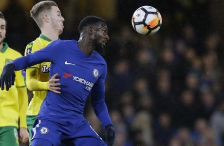 Chelsea's Tiemoue Bakayoko, right, duels for the ball with Norwich City's James Maddison during the English FA Cup third round replay between Chelsea and Norwich City at the Stamford Bridge, in London, Wednesday, Jan. 17, 2018. (AP Photo/Alastair Grant)