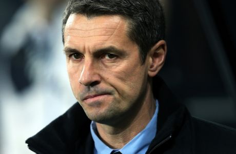 Aston Villa's manager Remi Garde awaits the start of the English Premier League soccer match between Newcastle United and Aston Villal at St James' Park, Newcastle, England, Saturday, Dec. 19, 2015. (AP Photo/Scott Heppell)