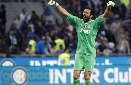 Juventus goalkeeper Gianluigi Buffon celebrates at the end of the Serie A soccer match between Inter Milan and Juventus at the San Siro stadium in Milan, Italy, Saturday, April 28, 2018. (AP Photo/Antonio Calanni)