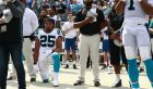 Carolina Panthers' Eric Reid (25) kneels as Cam Newton (1) stands during the national anthem before an NFL football game against the New York Giants in Charlotte, N.C., Sunday, Oct. 7, 2018. (AP Photo/Jason E. Miczek)