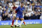 Arsenal's Hector Bellerin, left, vies for the ball with Chelsea's Eden Hazard during the English Premier League soccer match between Chelsea and Arsenal at Stamford bridge stadium in London, Saturday, Aug. 18, 2018. (AP Photo/Tim Ireland)