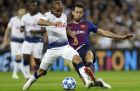 Tottenham midfielder Lucas, front left, duels for the ball with Barcelona midfielder Sergio Busquets during the Champions League Group B soccer match between Tottenham Hotspur and Barcelona at Wembley Stadium in London, Wednesday, Oct. 3, 2018. (AP Photo/Kirsty Wigglesworth)