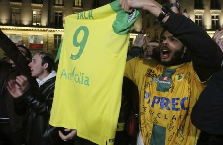 Supporters gather to pay tribute to Argentinian soccer player Emiliano Sala, in Nantes, western France, Tuesday, Jan. 22, 2019. The search for the missing plane taking Argentine soccer player Emiliano Sala to his new team in Wales was called off for the night on Tuesday with authorities not expecting to find any survivors in the English Channel. (AP Photo/David Vincent)