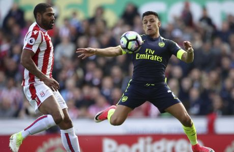 Arsenal's Alexis Sanchez, right, and Stoke City's Glen Johnson battle for the ball during their English Premier League soccer match at the bet365 Stadium, Stoke-on-Trent, England, Saturday, May 13, 2017. (Nick Potts/PA via AP)