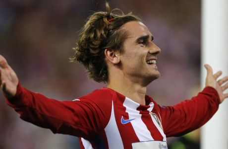 FILE - In this Wednesday, April 12, 2017 file photo, Atletico's Antoine Griezmann celebrates after scoring from the penalty spot the opening goal of the game during the Champions League quarterfinal first leg soccer match between Atletico Madrid and Leicester City at the Vicente Calderon stadium in Madrid, Spain. (AP Photo/Paul White, File)