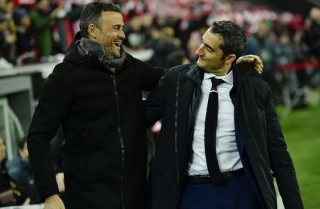 Barcelona's manager Luis Enrique, left smiles beside Athletic Bilbao's manager Ernesto Valverde, during the Spanish Copa del Rey, 16 round, first leg soccer match, between FC Barcelona and Athletic Bilbao, at San Mames stadium, in Bilbao, northern Spain, Thursday, Jan.5, 2017. FC Barcelona lost the match 2-1. (AP Photo/Alvaro Barrientos)
