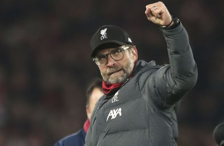 Liverpool's manager Jurgen Klopp celebrates at the end of the English Premier League soccer match between Liverpool and Manchester City at Anfield stadium in Liverpool, England, Sunday, Nov. 10, 2019. Liverpool won 3-1. (AP Photo/Jon Super)