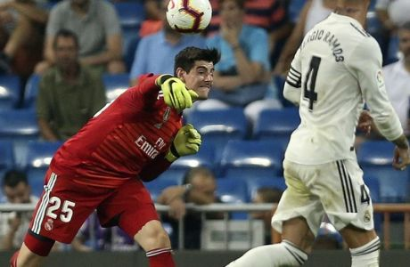 Real Madrid's goalkeeper Thibaut Courtois, left, throws the ball during the Spanish La Liga soccer match between Real Madrid and Leganes at the Santiago Bernabeu stadium in Madrid, Saturday, Sep. 1, 2018. (AP Photo/Andrea Comas)