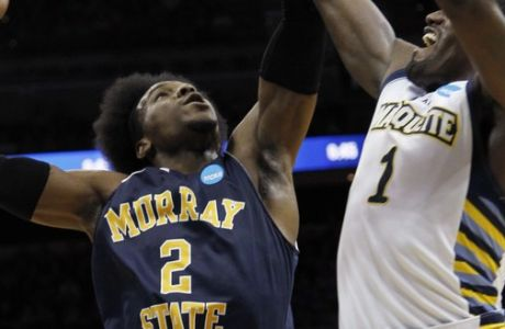 Murray State forward Edward Daniel (2) fights Marquette guard Darius Johnson-Odom (1) for a rebound in the first half of their NCAA third-round tournament college basketball game in Louisville, Ky., Saturday, March 17, 2012. (AP Photo/Dave Martin)