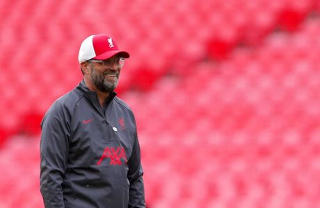 Liverpool manager Jurgen Klopp smiles during warm up before the English FA Community Shield soccer match between Arsenal and Liverpool at Wembley stadium in London, Saturday, Aug. 29, 2020. (Andrew Couldridge/Pool via AP)