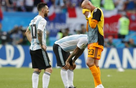 Argentina's Lionel Messi, left, and Argentina goalkeeper Wilfredo Caballero, right, react at the end of their round of 16 match between France and Argentina, at the 2018 soccer World Cup at the Kazan Arena in Kazan, Russia, Thursday, June 28, 2018. (AP Photo/Ricardo Mazalan)