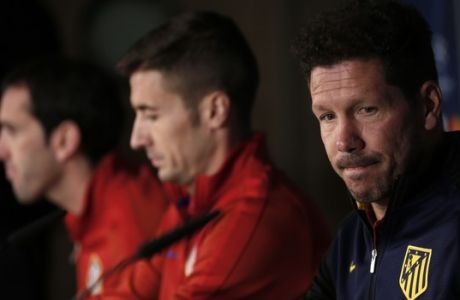 """Atletico Madrid head coach Diego Simeone, right, Diego Godin, left, and Gabriel Fernandez """"Gabi"""" arrive to a news conference at the Santiago Bernabeu stadium in Madrid, Monday, May 1, 2017. Atletico Madrid will play a Champions League first leg semifinal soccer match against Real Madrid on Tuesday 2. (AP Photo/Francisco Seco)"""