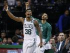 Boston Celtics guard Marcus Smart (36) and forward Jayson Tatum cheer from the bench along with injured Gordon Haywood who watches in street clothes, far right, during the fourth quarter of Game 1 of the NBA basketball Eastern Conference Finals against the Cleveland Cavaliers, Sunday, May 13, 2018, in Boston. The Celtics won 108-83. (AP Photo/Michael Dwyer)