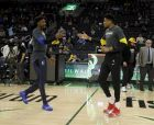 Milwaukee Bucks' Giannis Antetokounmpo, right, and Dallas Mavericks' Kostas Antetokounmpo, left, greet at midcourt before an NBA basketball game Monday, Jan. 21, 2019, in Milwaukee. (AP Photo/Aaron Gash)